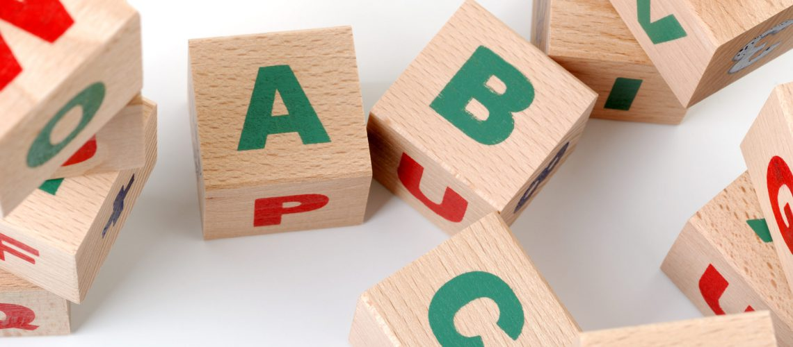 The alphabet. Letters drawn on wooden cubes. A children's toy